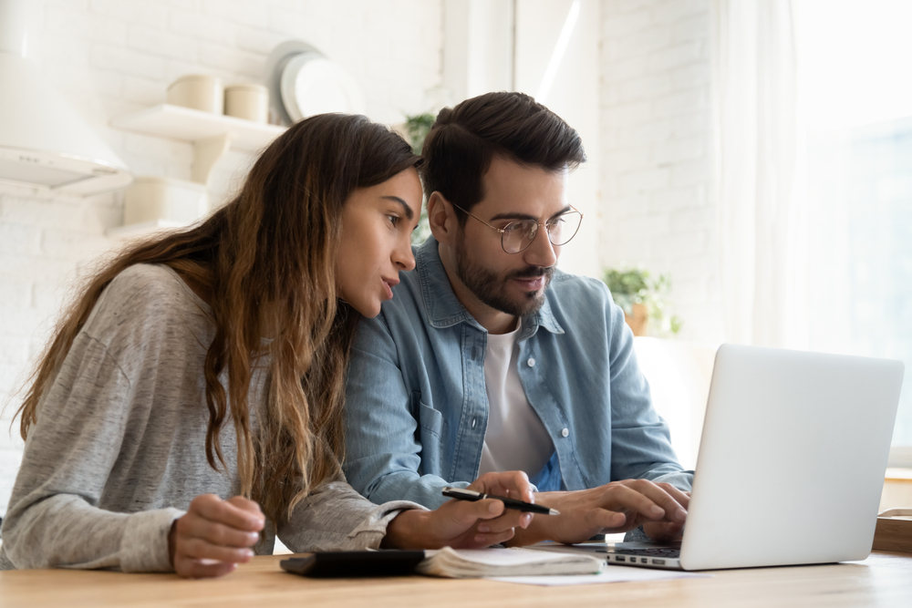 Focused young couple looking for tenants for rental property