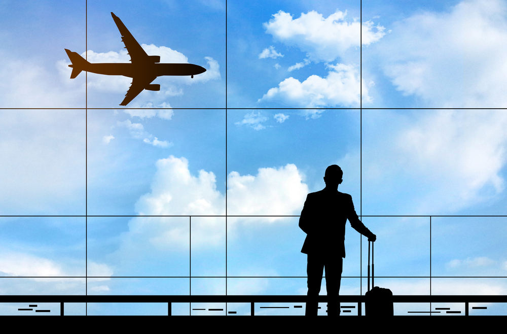 Silhuette of Business man traveling (Turn Your Vacation into a Tax-Deductible Business Travel)