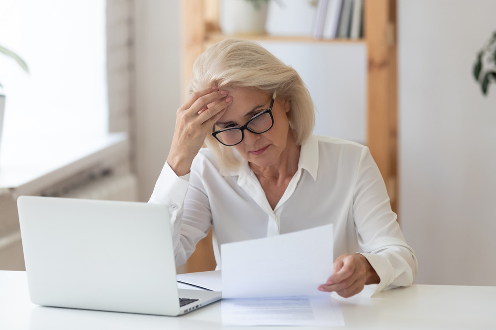 Lady stressed by filing his taxes late (Big Mistake Filing Your Tax Return Late)